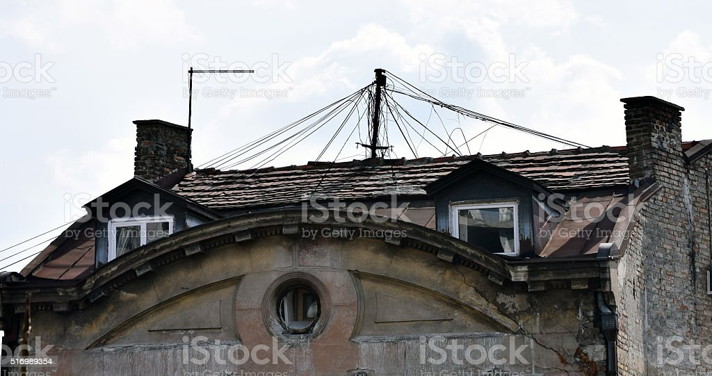Old roof with a bunch of cables stock photo