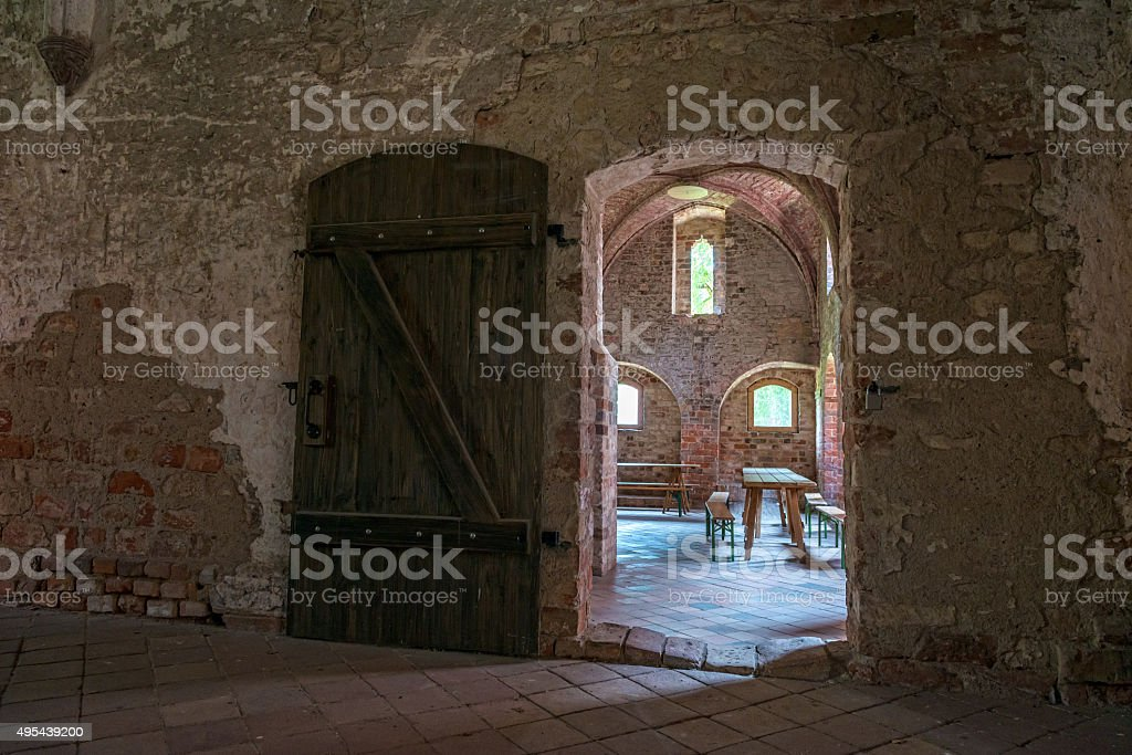 old room with wooden door in an old monastery stock photo