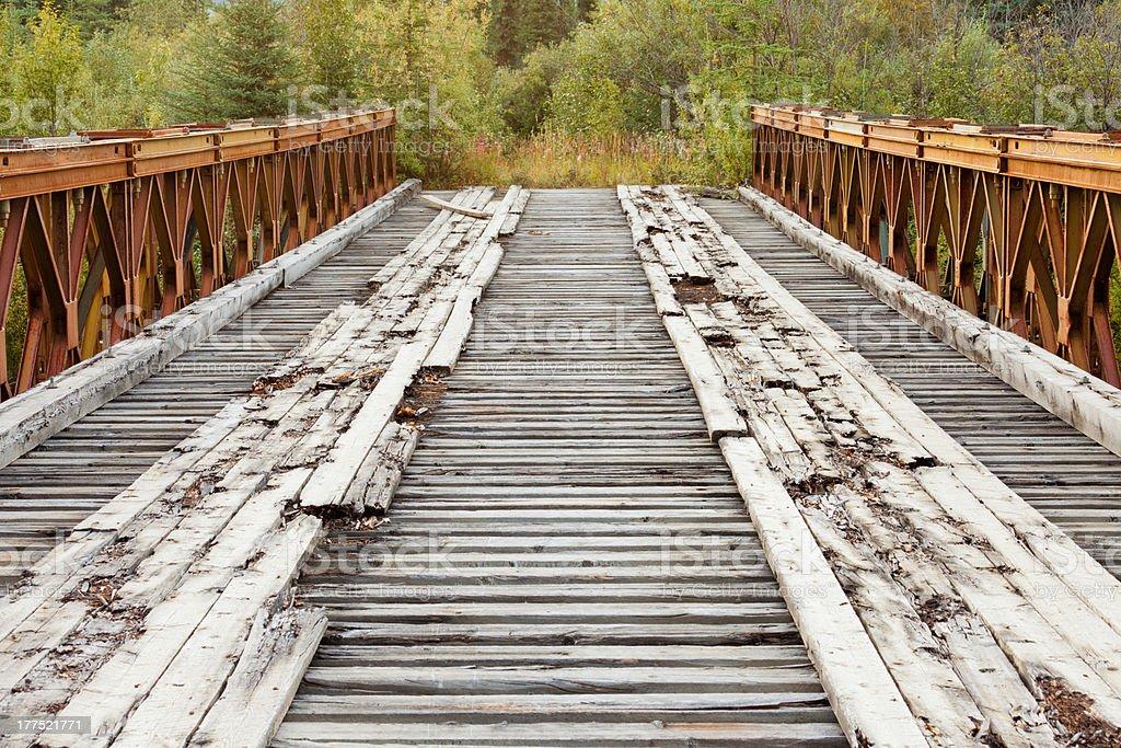Old rotten abandoned bridge leading to nowhere royalty-free stock photo