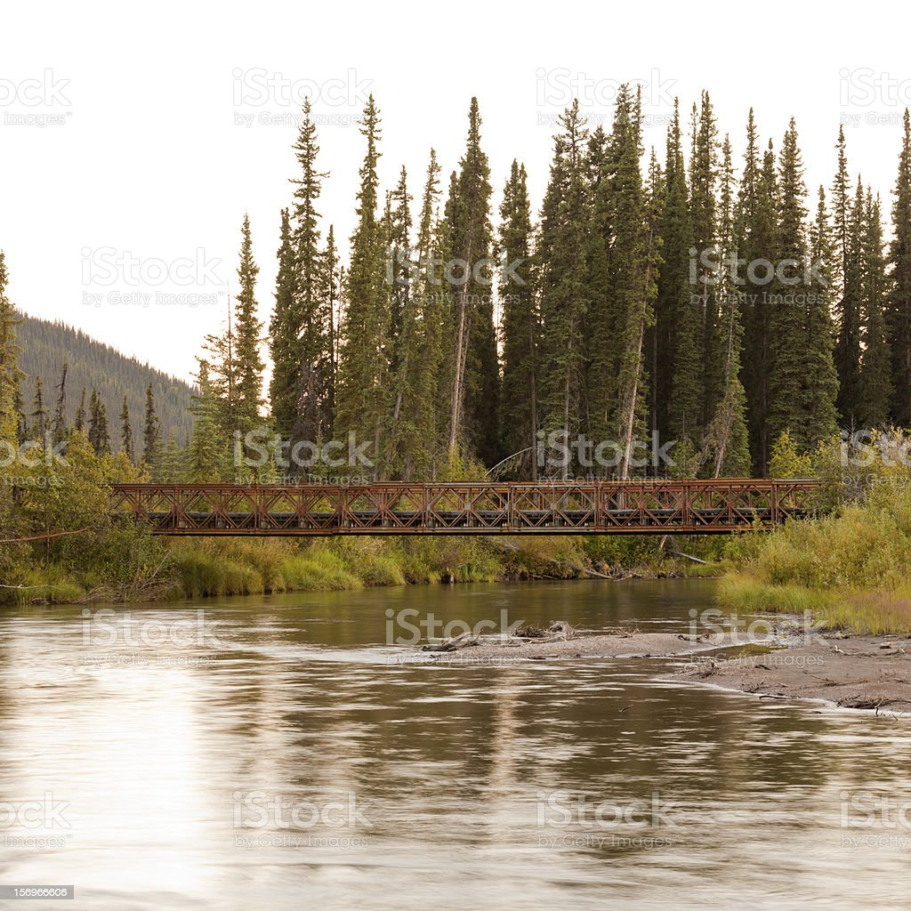 Old rotten abandoned bridge over McQuesten River royalty-free stock photo