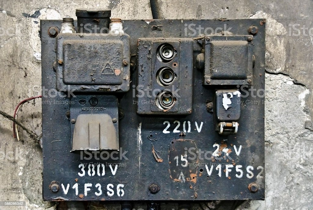 old rotten electric fuse panel stock photo