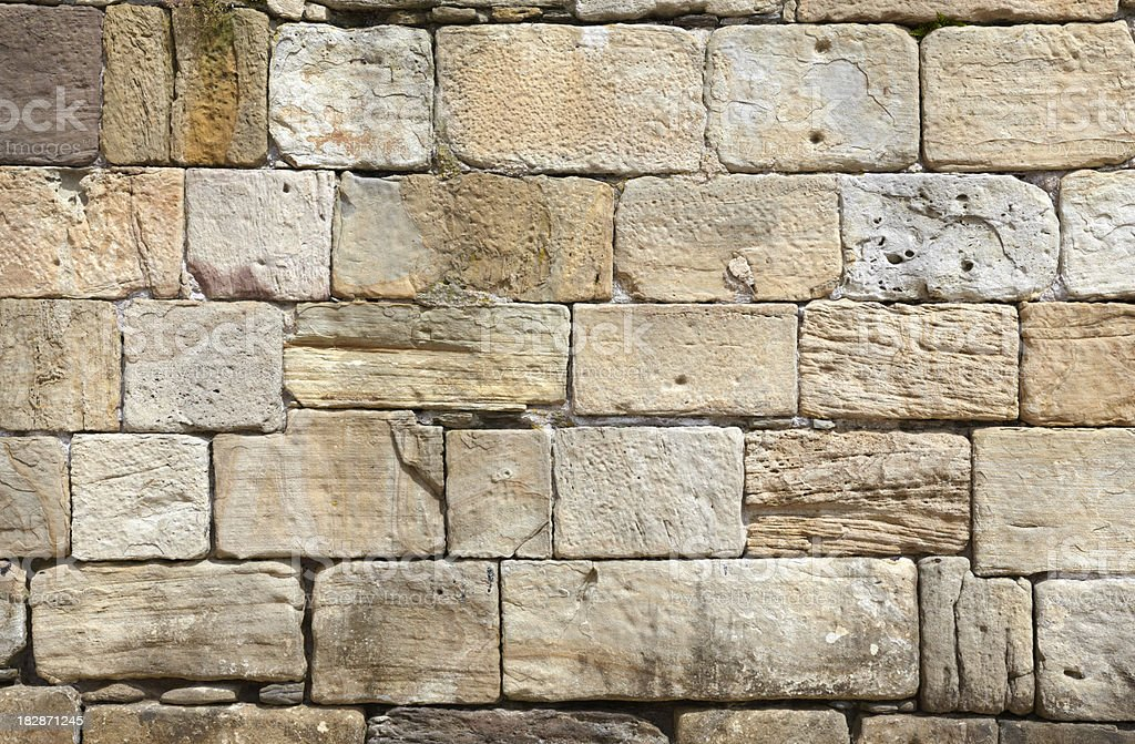 Old rough rustic sandstone block wall royalty-free stock photo