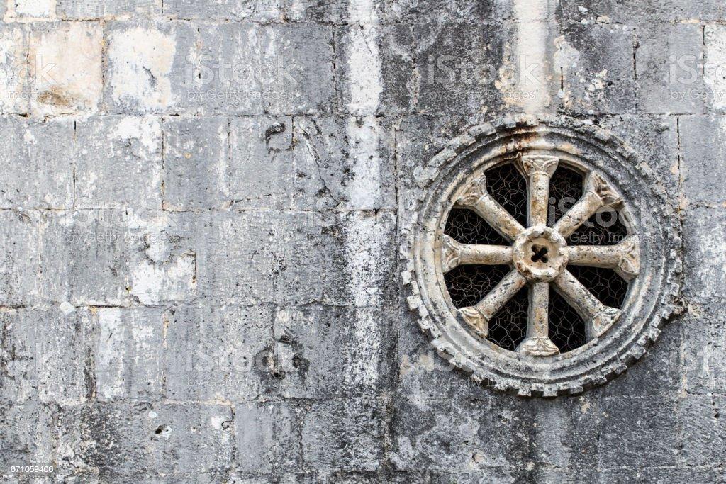 Old round circle stone adornment pattern decoration church rosette window stock photo