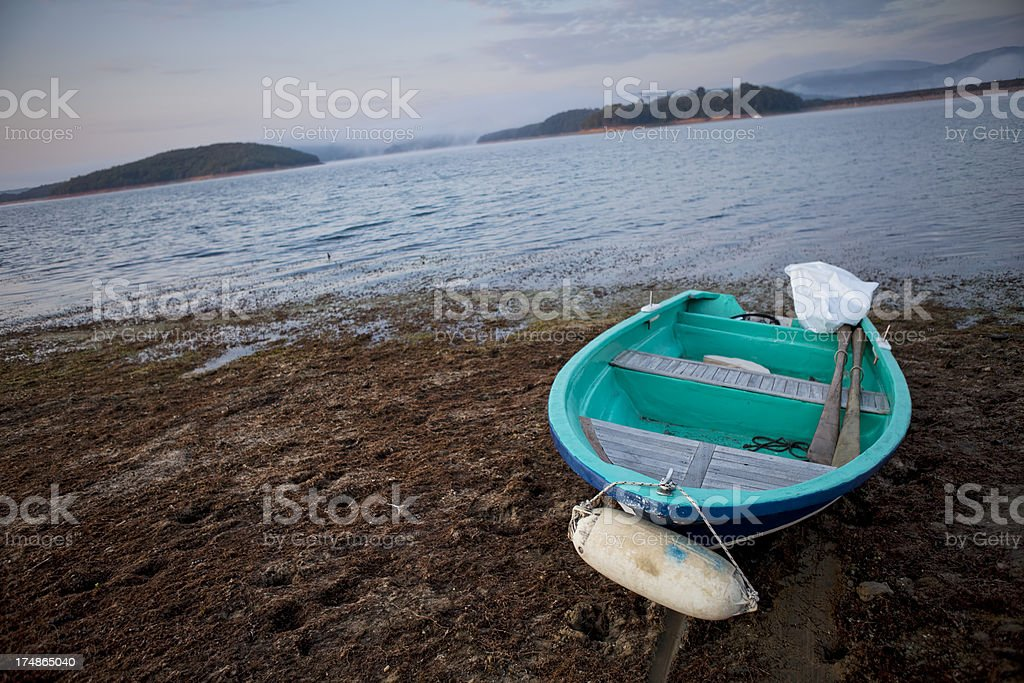 old rowboat by the lake royalty-free stock photo