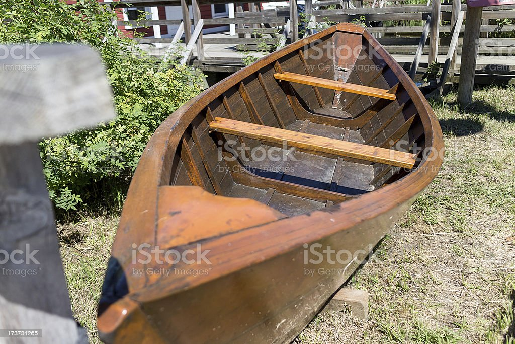 old rowboat on lawn royalty-free stock photo