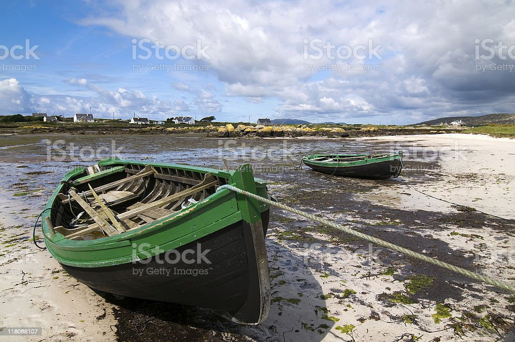 Old rowboats on the beach royalty-free stock photo