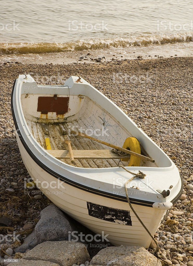 Old rowing boat by the sea stock photo