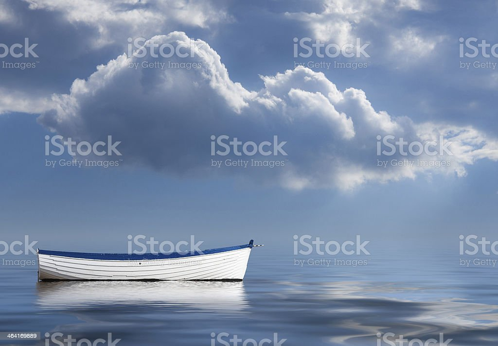 Old rowing boat marooned at sea stock photo