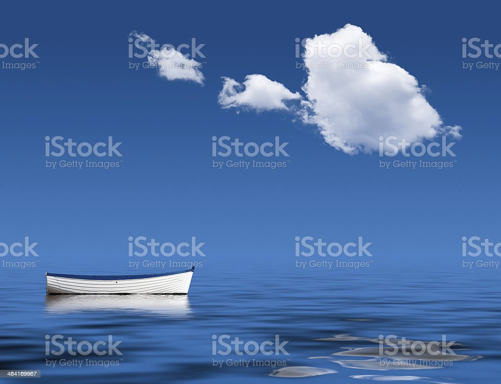 Old rowing boat marooned at sea royalty-free stock photo