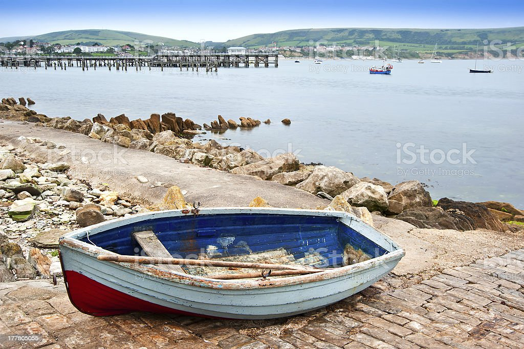 Old rowing boat on launch slipway of seaside town royalty-free stock photo