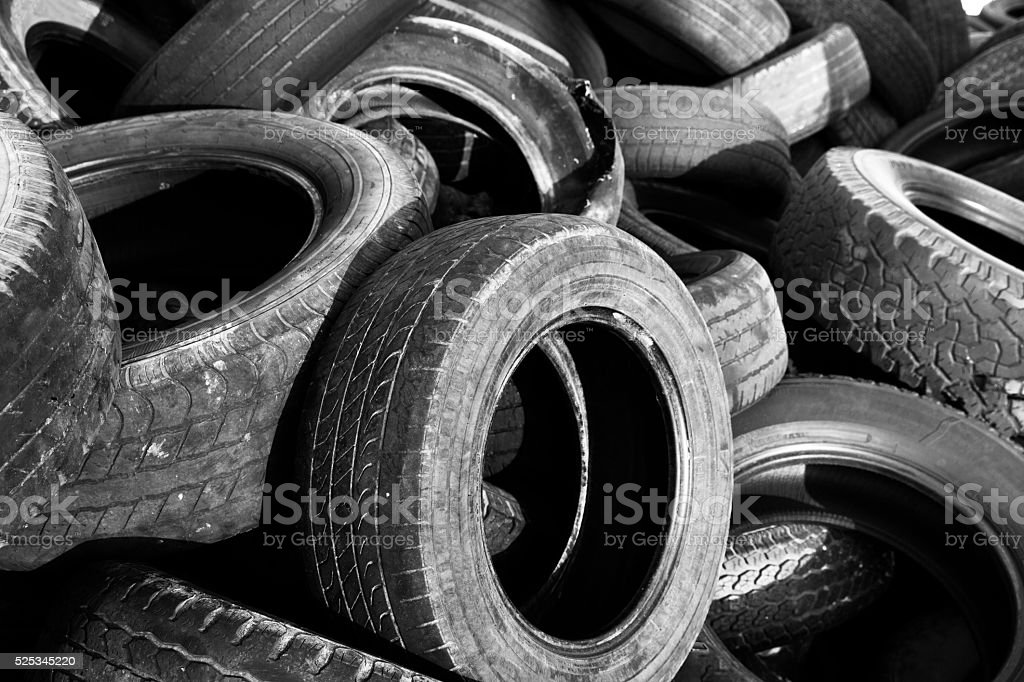Old Rubber Tires Stacked on Top stock photo