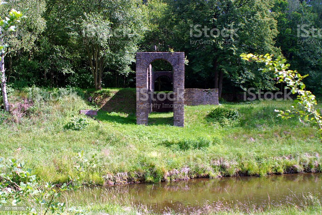 old ruin at a river in germany stock photo