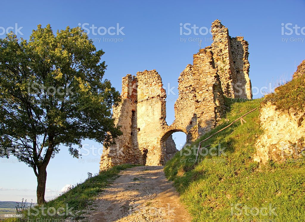 old ruin castle in light of sunset stock photo