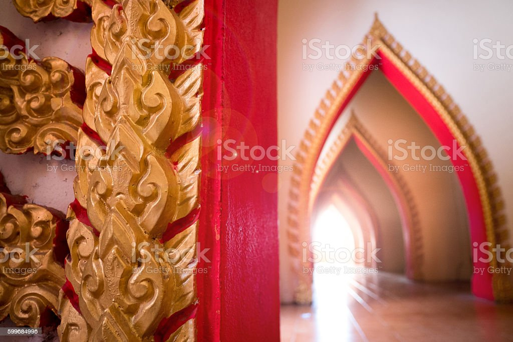 Old ruined arch in ancient temple at sunset stock photo