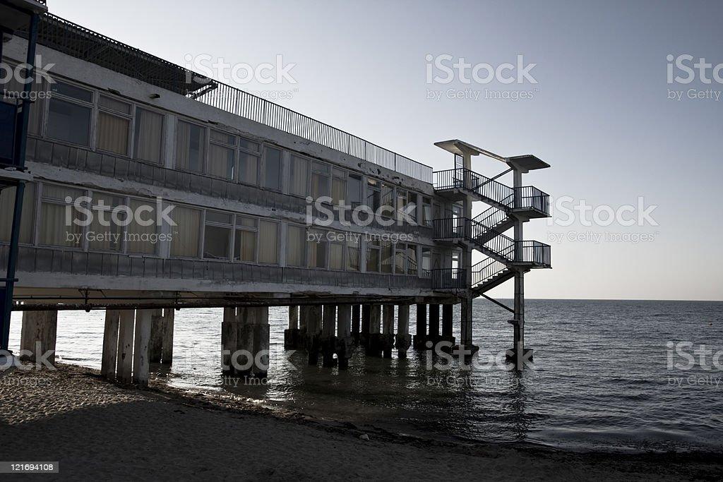 old ruined hotel on the black sea Crimea stock photo