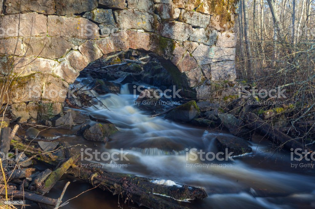 Old ruined mill on the river. stock photo