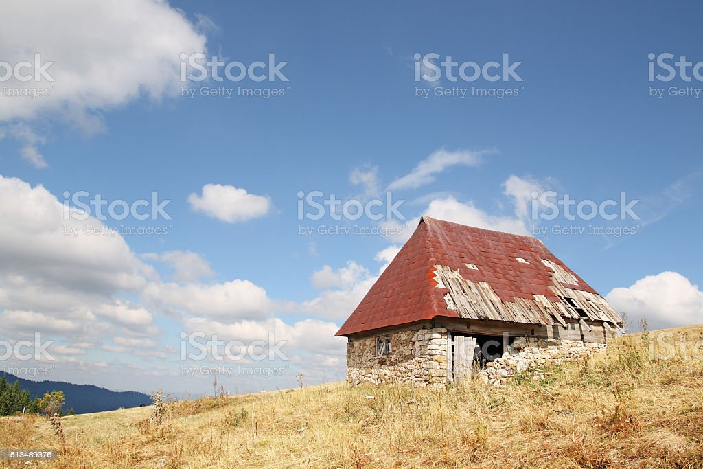 Old ruined mountain hut stock photo