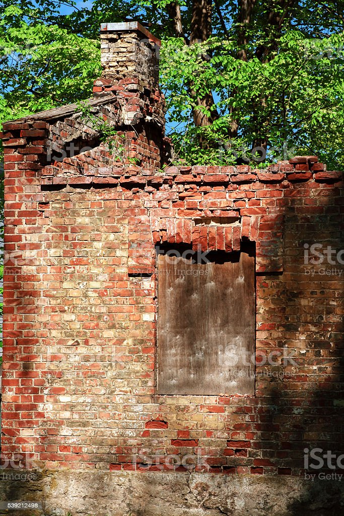 Old ruined of red brick house. stock photo