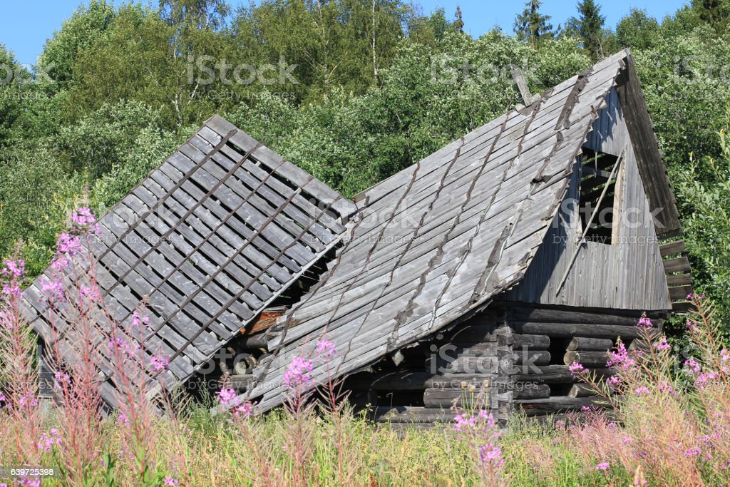 Old ruined wooden house stock photo