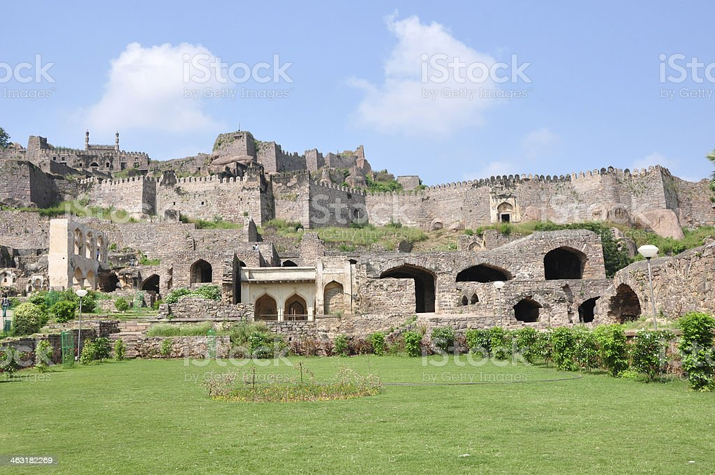 Old ruins surrounded by grass and small trees stock photo