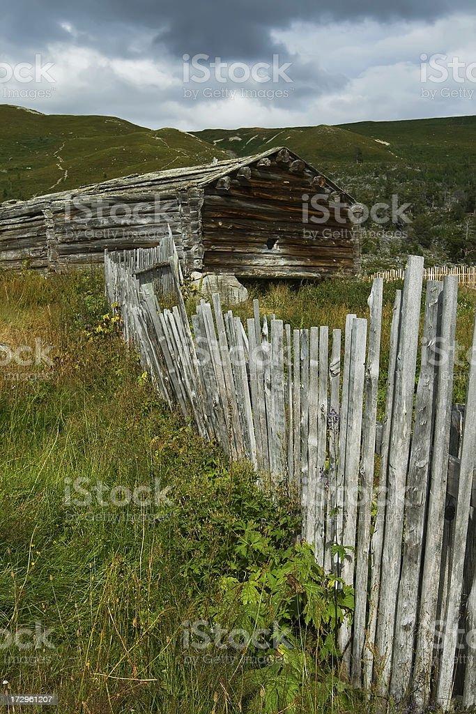 Old run-down pasture summer mountain farm. royalty-free stock photo