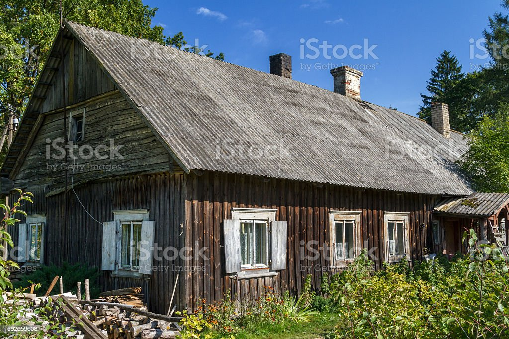 Old rural house covered with eternit roof stock photo