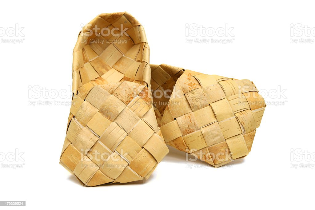 Old Russian bast shoes. Footwear named lapty stock photo