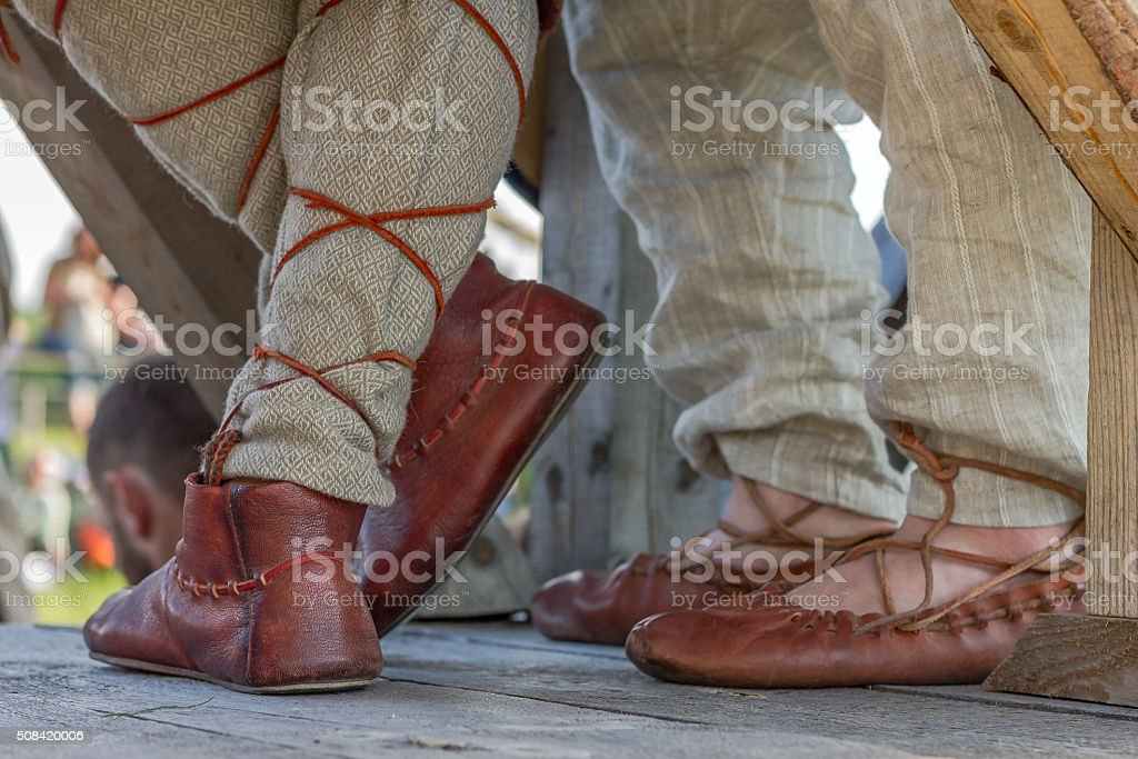 Old Russian leather sandals on mens feet stock photo