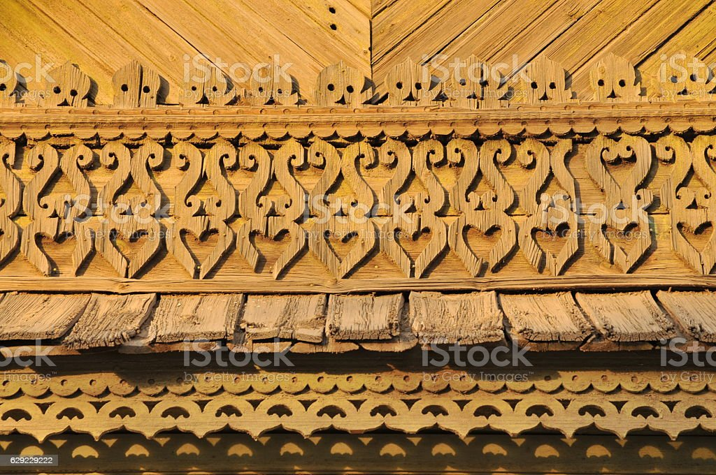 Old Russian pediment (fragment) with elements of decoration. stock photo
