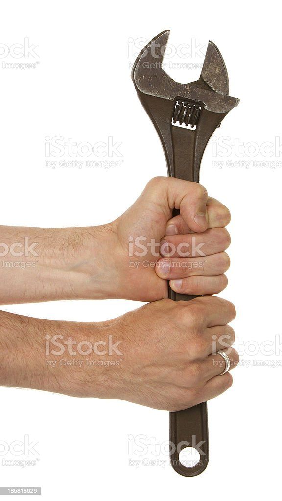 Old rusted adjustable vector wrench in a hand royalty-free stock photo
