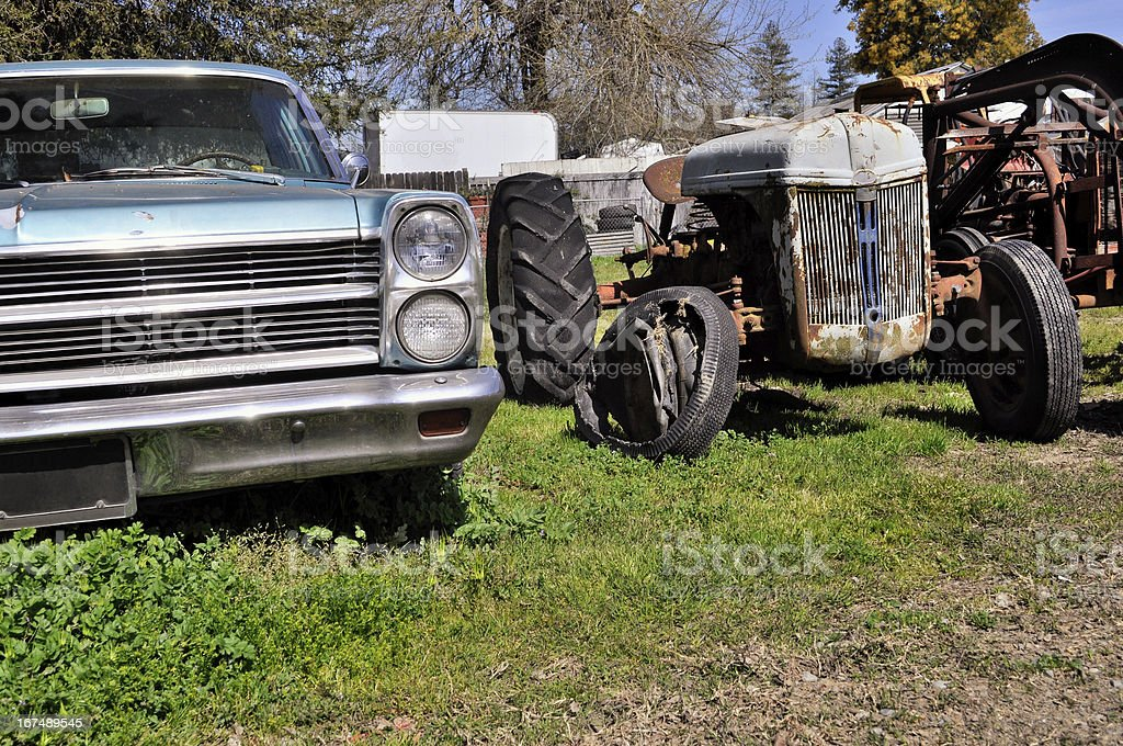Old rusted car and tractor royalty-free stock photo