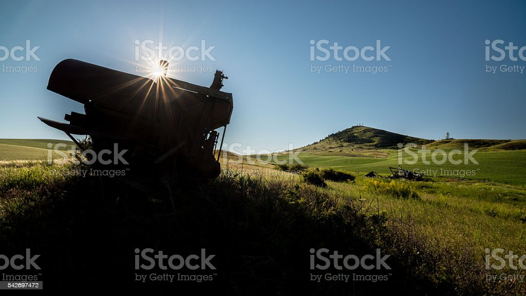 Old rusted combine and sunstar at Steptoe Butte stock photo