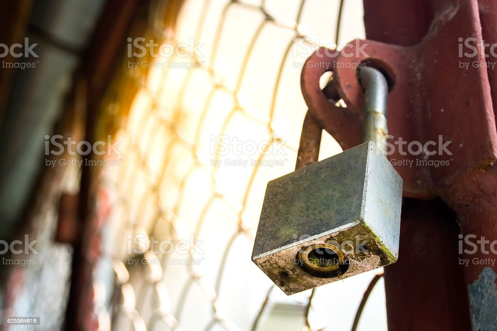 Old rusted gate is lock with a chain. stock photo