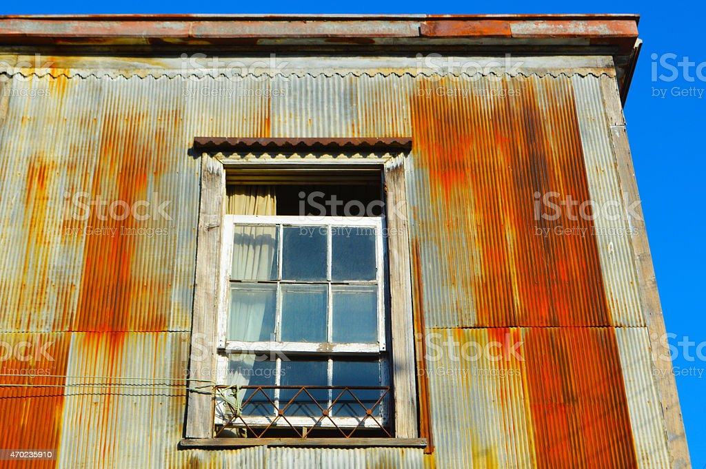 Old rusted house with a window in Valpara?so stock photo