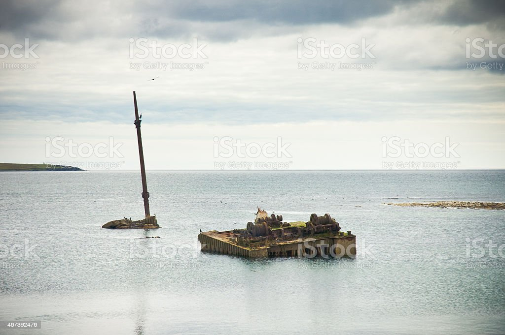 Old rusted sunken boat Orkney island, Scapa Flow, Scotland stock photo
