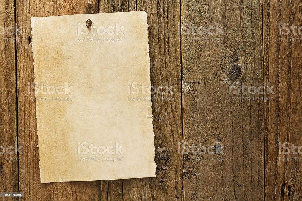 Old rustic aged wanted cowboy sign on parchment stock photo