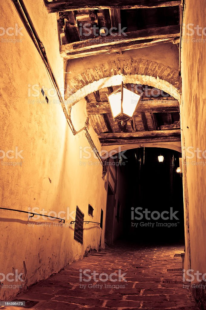Old Rustic Alley With Lamp By Night, Cortona, Tuscany royalty-free stock photo
