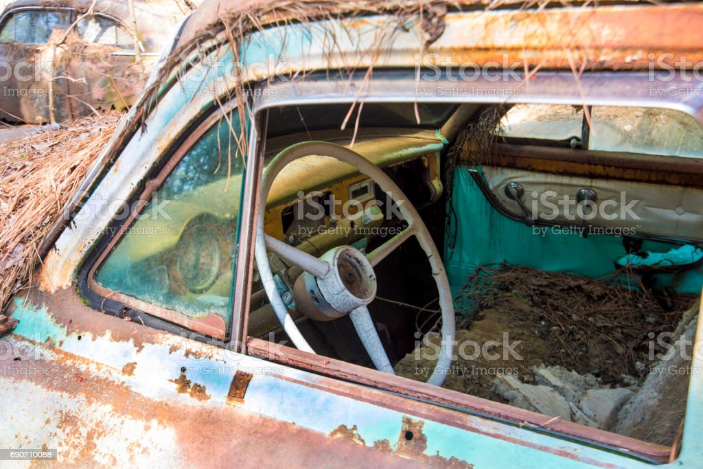 Old rustic car was long ago abandoned. stock photo