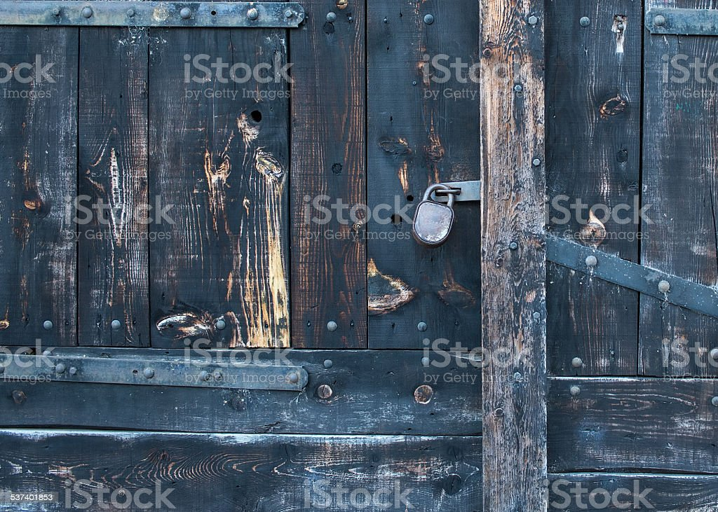 Old rustic faded wood gate with a lock stock photo