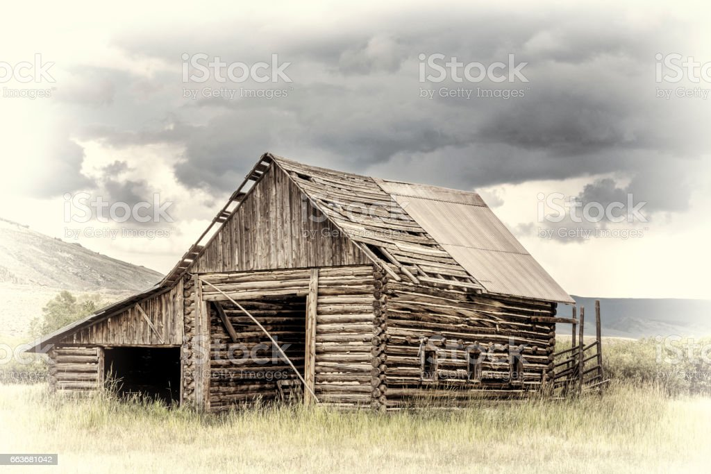 old rustic log barn in Rocky Mountains stock photo