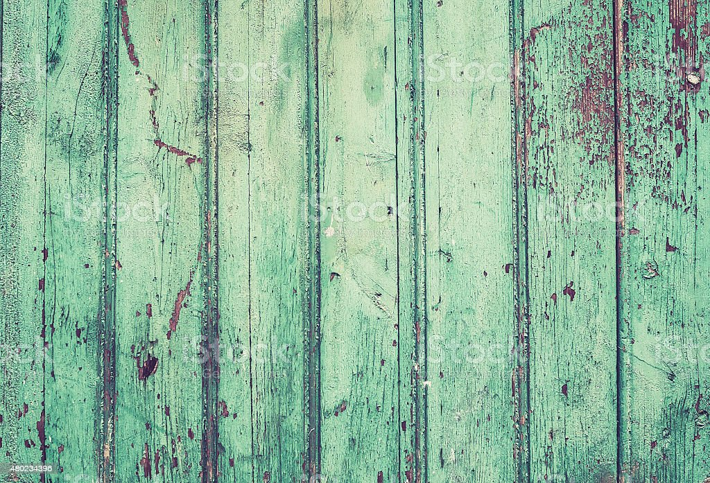 Old rustic painted cracky green wooden texture stock photo