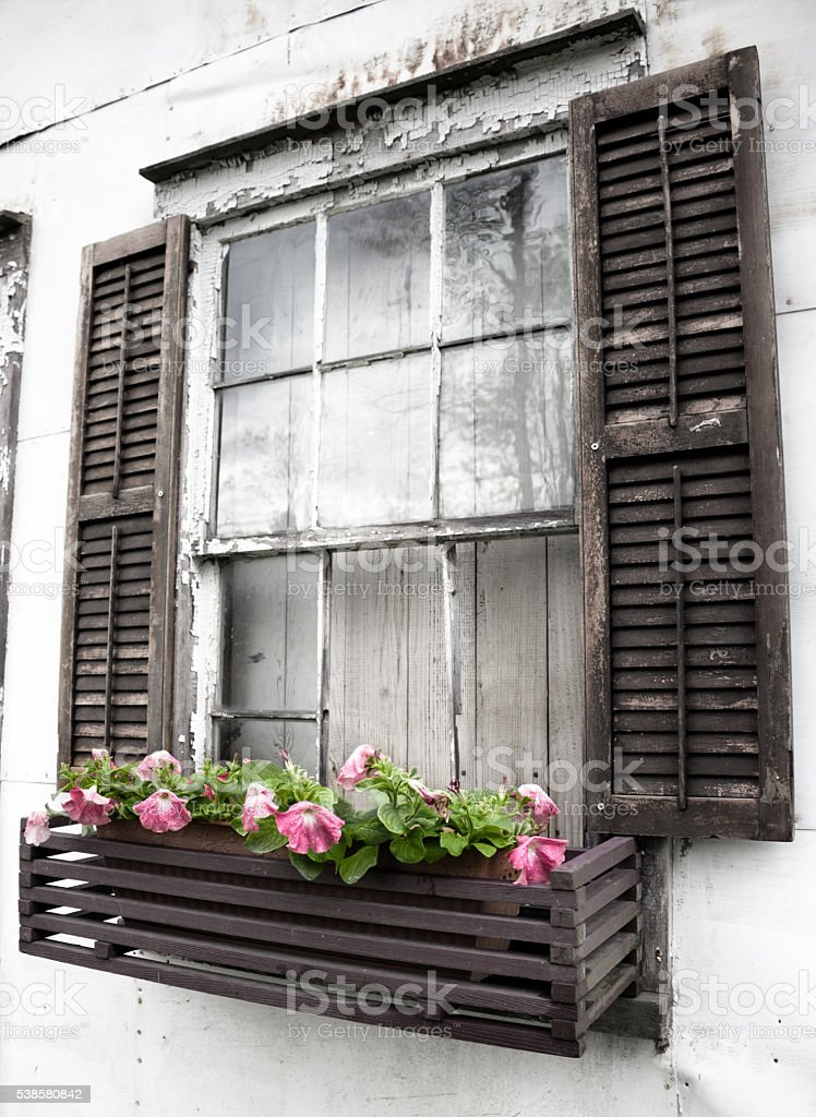 Old Rustic Window Flowerbox stock photo