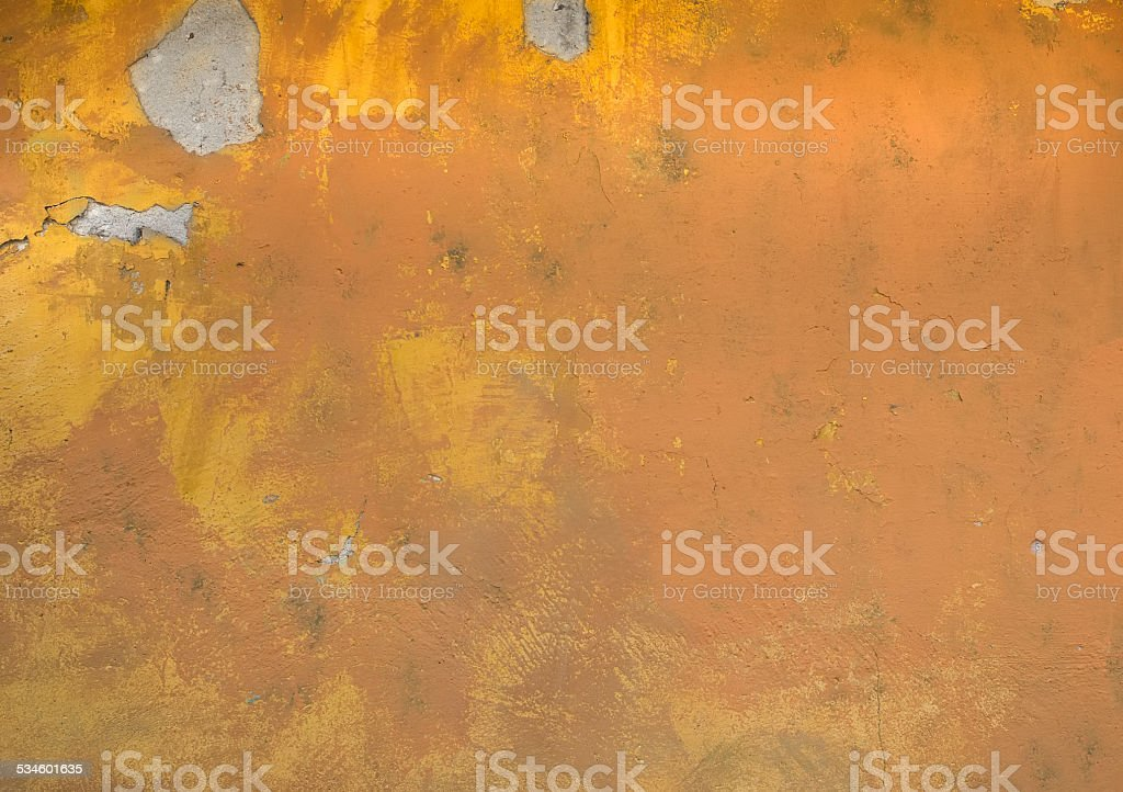 Old rustic yellow painted stone texture stock photo