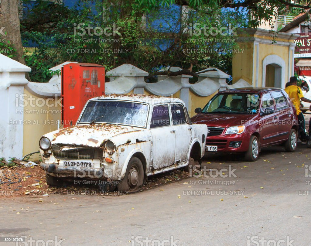 Goa, India - March 01, 2015: Old rusty abandoned car brand Ambassador stock photo