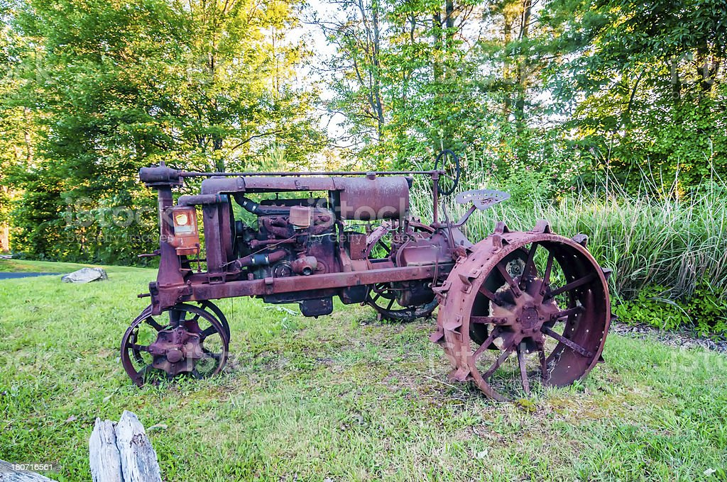 old rusty agriculture farm tractor stock photo
