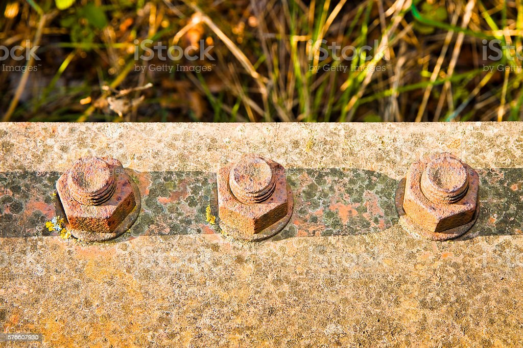 Old rusty anchor bolt with iron plate stock photo