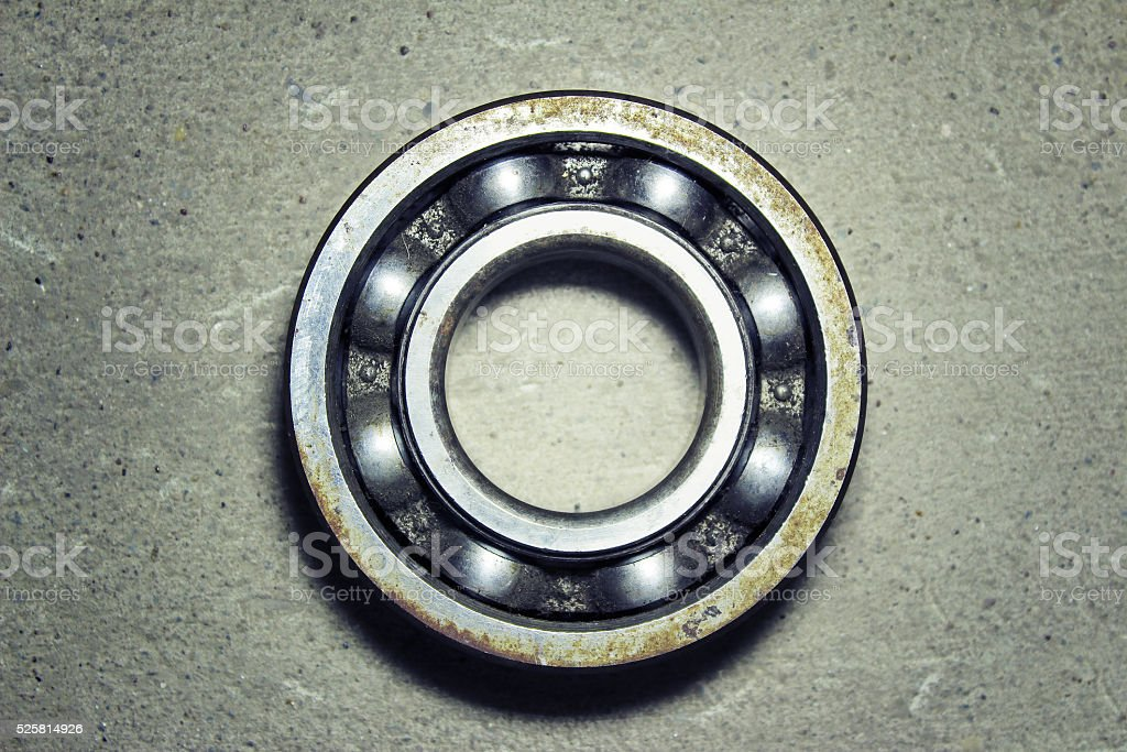 Old rusty bearing on a white background stock photo