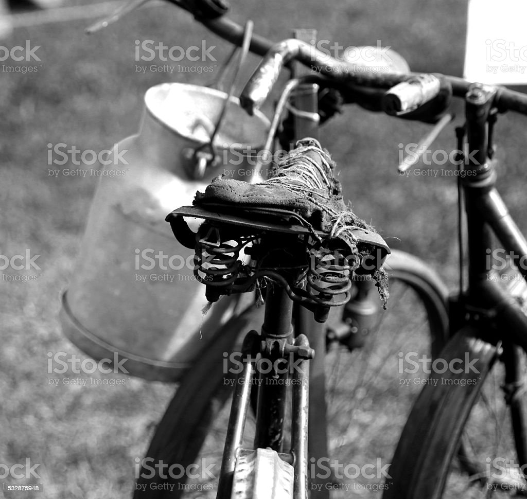 Old rusty bicycle milkman and the Milk Canister stock photo