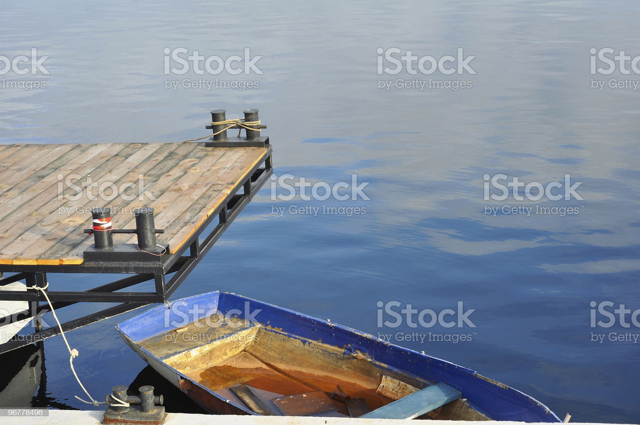 old rusty boat on the water royalty-free stock photo