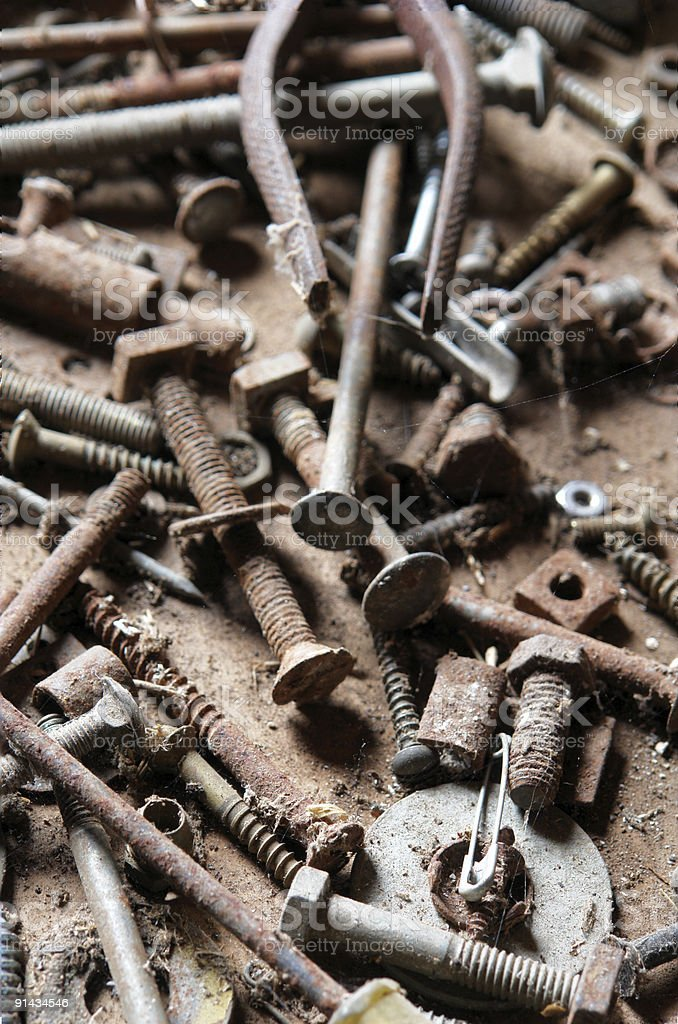 Old rusty bolts and nails / tools. Focus on front. stock photo